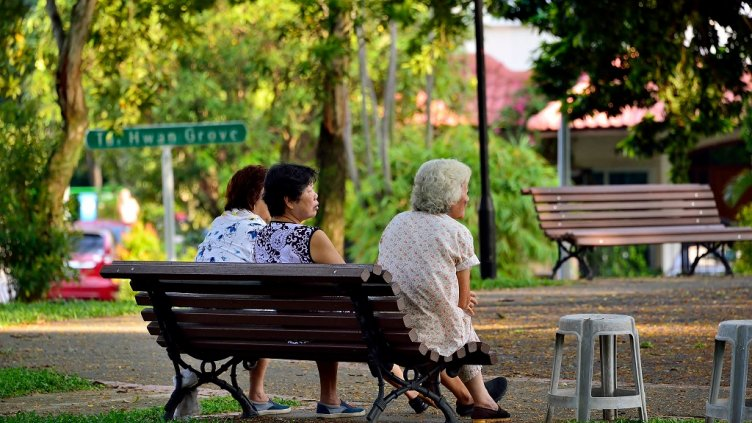 Singapore - May 12th 2018: A group of elderly Chinese ladies sitting and relaxing on a bench in a park in Serangoon Gardens with soft early morning light; Shutterstock ID 1089334580; Departmental Cost Code : 162800; Project Code: GBLMKT; PO Number: GBLMKT; Other: