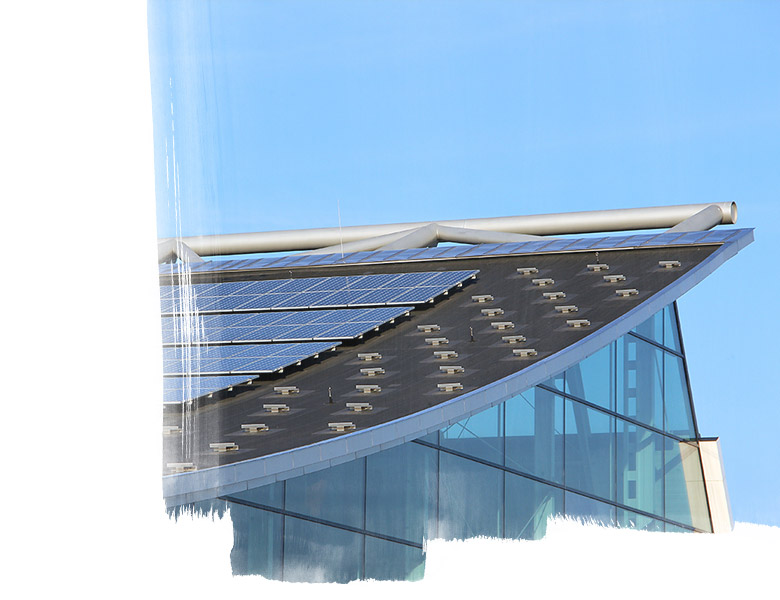 Glass building with solar panels on roof